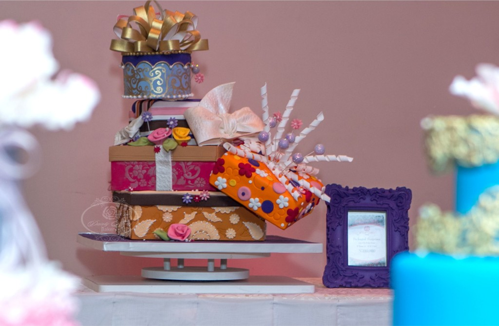 Cake Shaped Like Multiple Colored Gift Boxes