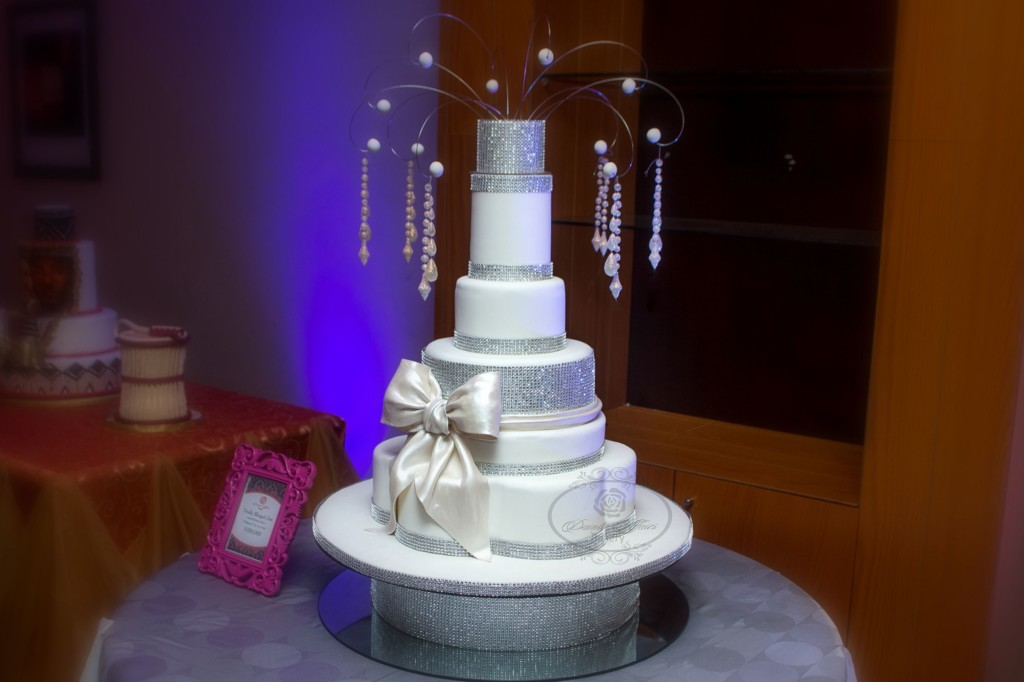 Multi-Tiered White Cake with Bow and Decoration at Top