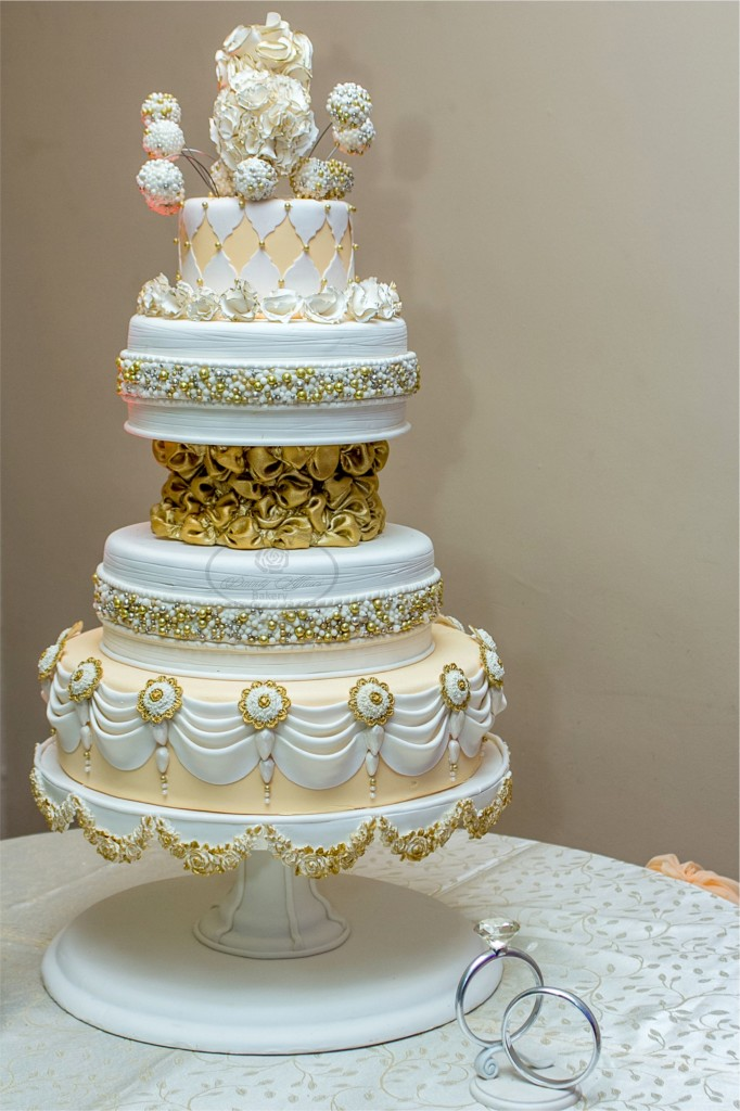 Multi-Tiered and Shaped Wedding Cake with Gold Features