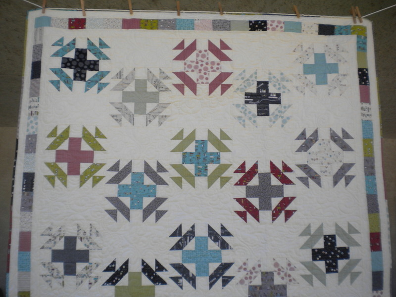 White Quilt with Accented Cross Patterns