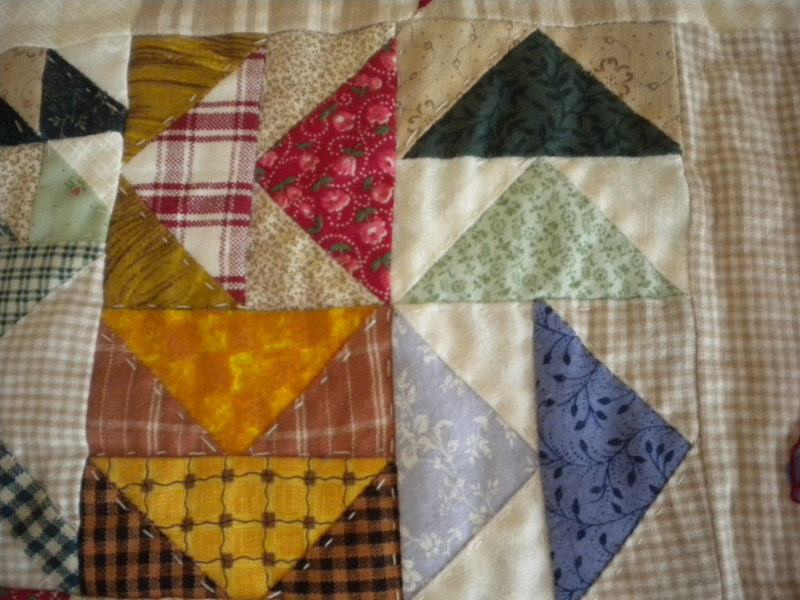 Flying Geese Block Featuring Decorative Stitching and Sections