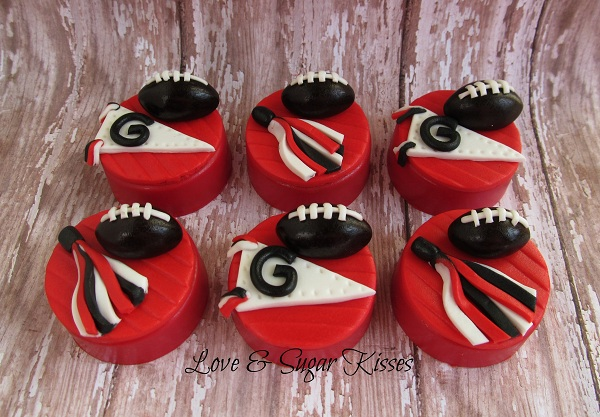 Cupcakes Decorated with Footballs, Pom Poms and Flags