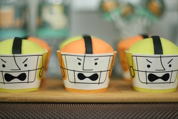 Cupcakes Decorated Like Football Players in Masks