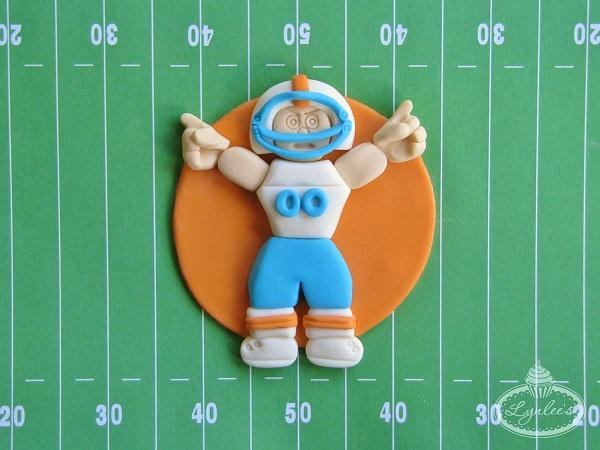 Cupcake Shaped Like Football Player on Field