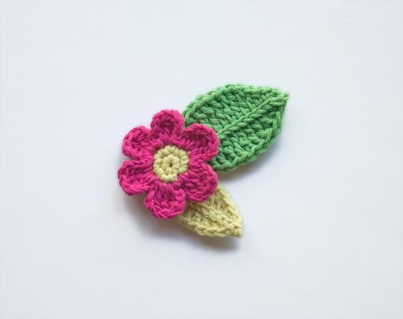 Crocheted Pink Flower with Green Leaves