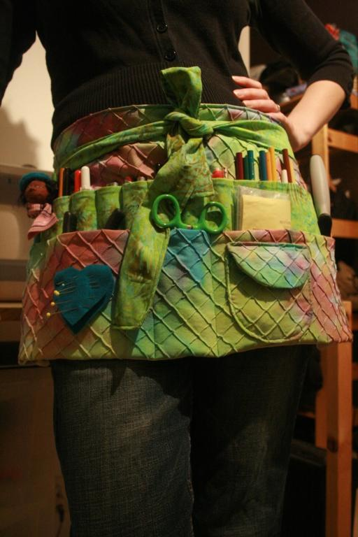 Woman Modeling Green Textured Apron with Lots of Pockets