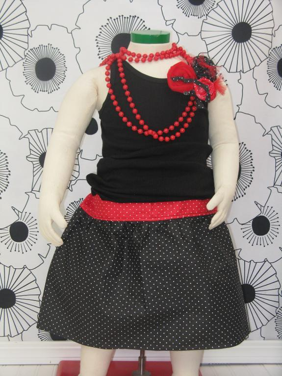 Mannequin Modeling Black Shirt, Colorful Skirt and Red Beads