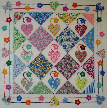 Colorful Diamond Patterned Quilt Hanging on Wall