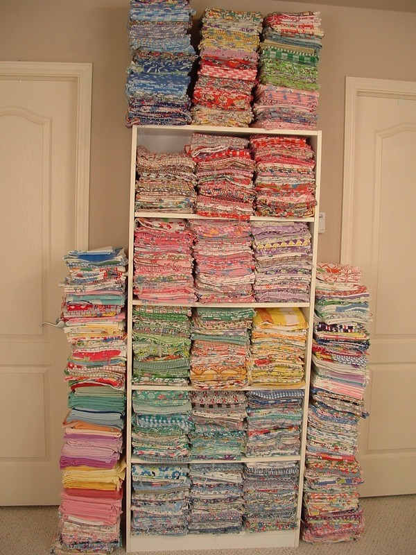 Shelf Stacked with Hundreds of Different Fabrics