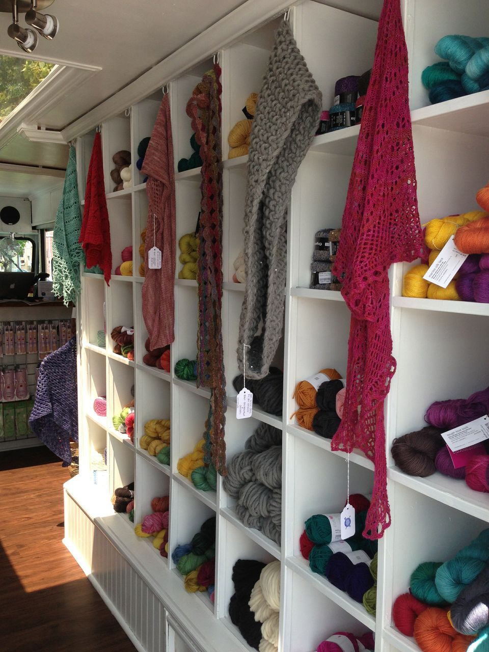 Shelves of Yarn and Knit Scarves Inside the Yarnover Truck
