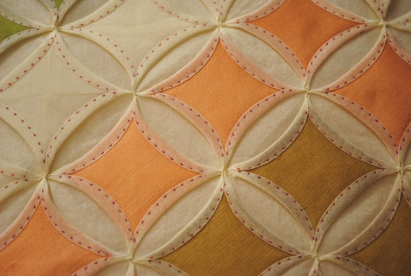 White and Orange Quilt with Raised Diamond-in-Circle Pattern