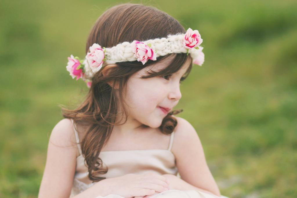 Little Girl Wearing Knit Headband with Flowers