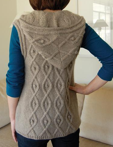 Woman Modeling Hooded Sleeveless Sweater