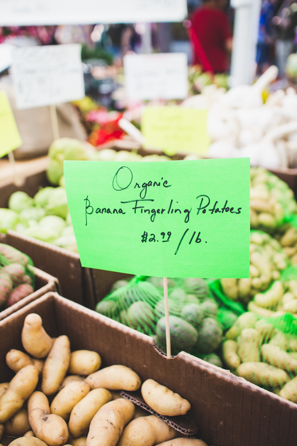 Sign for Organic Produce Amidst Boxes of Vegetables