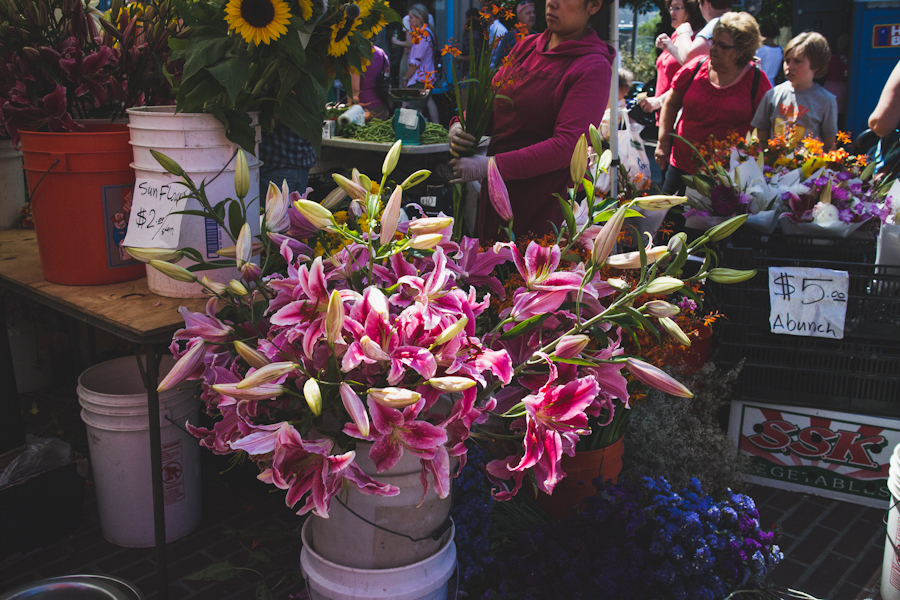 Bunches of Flowers in Buckets for Sale at Farmers Market
