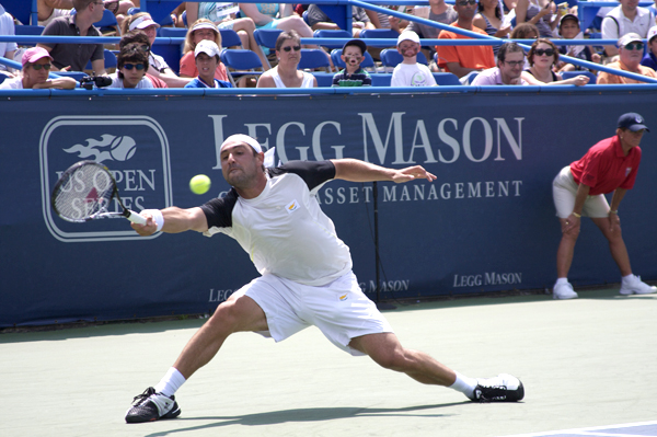 Shot of Tennis Player Lunging for Ball