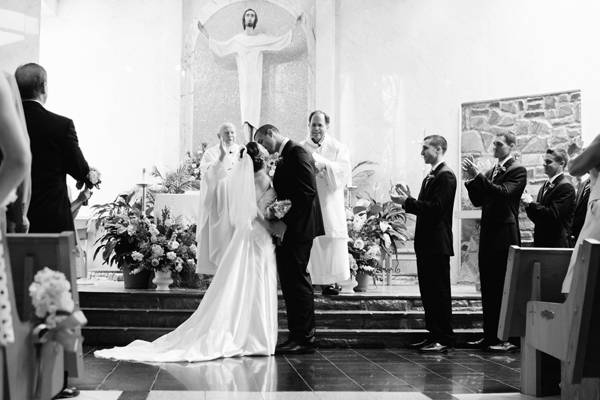 Black and White Photo of Wedding Couple at Alter