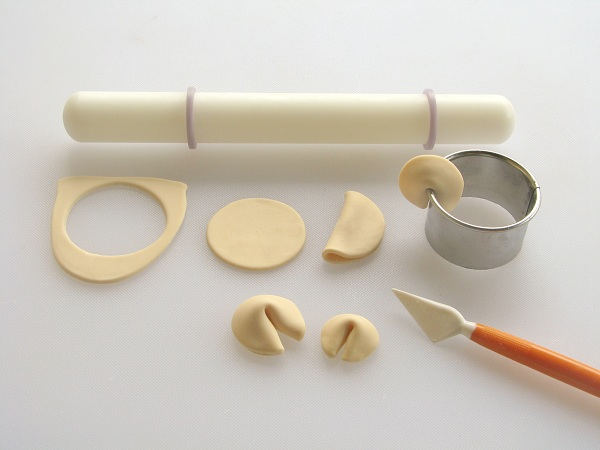 Fondant Tools and Fondant Cut and Shaped into Fortune Cookies