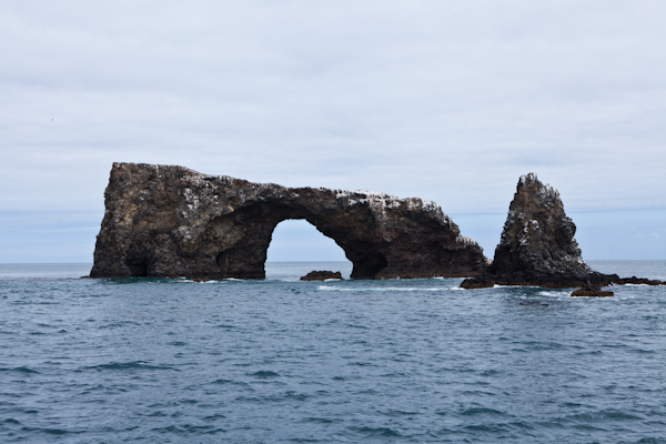 Normal Image of Rock Formations in Water, Grey Skies