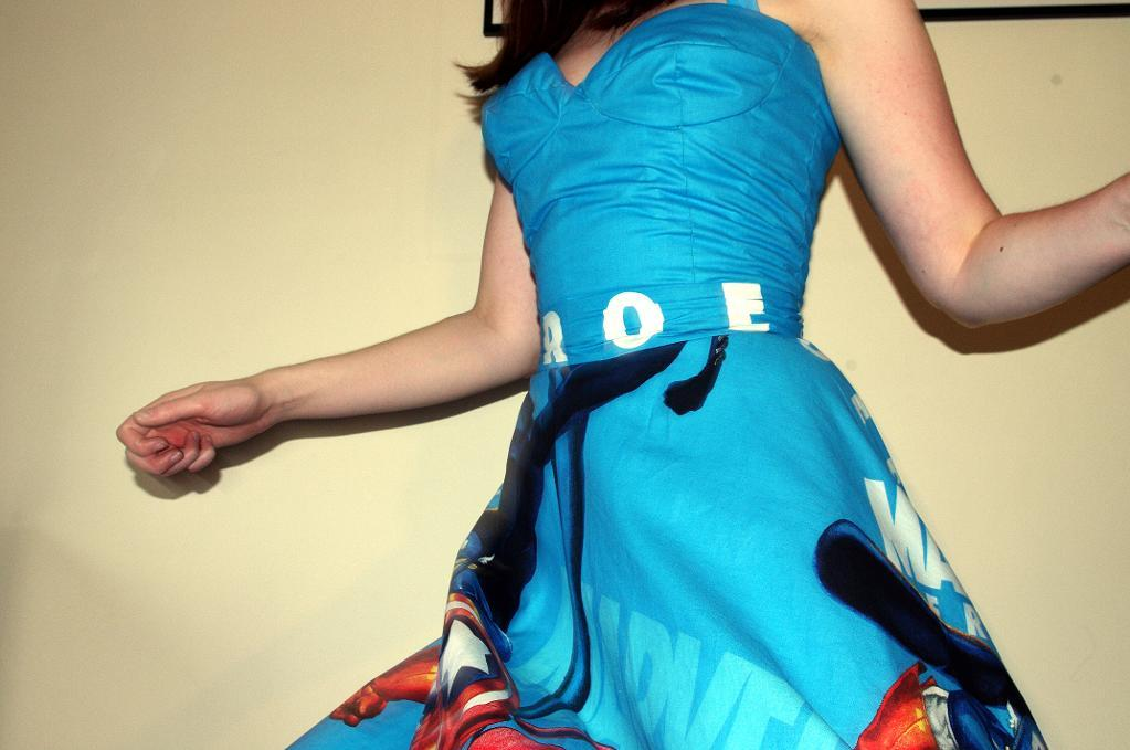 Girl Spinning in Blue Comic-Patterned Retro Dress