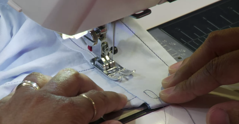 Woman Sewing Cuff on Sewing Machine