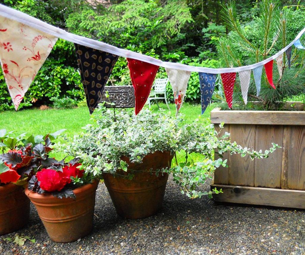 Patriotic Pennant Bunting Hanging on Patio with Plants