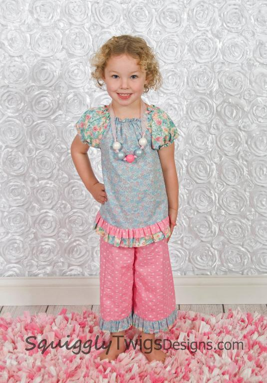Little Girl Modeling Colorful Outfit