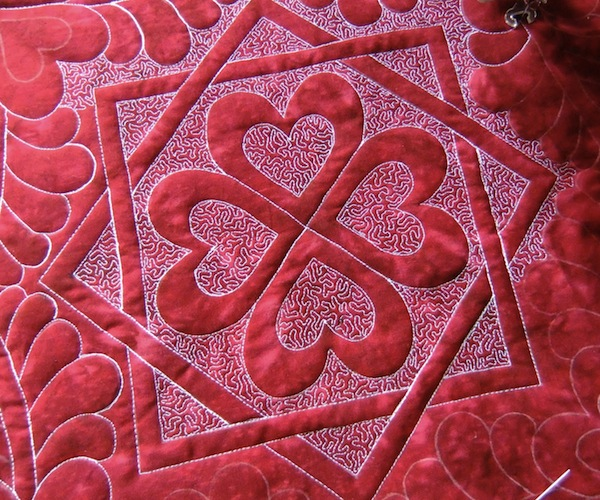 Red and Pink Quilt with Hearts Design