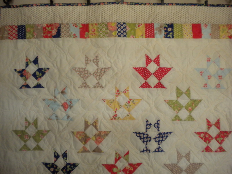 White Quilt with Triangle Pattern and Colorful Border