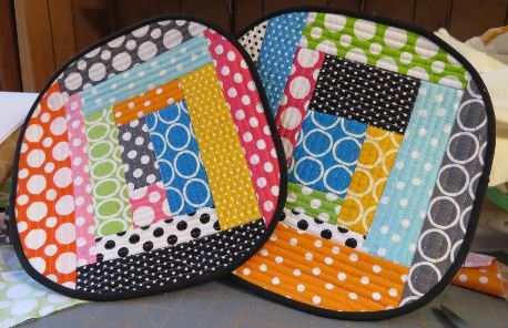 Two Colorfully Patterned Quilted Hot Pads