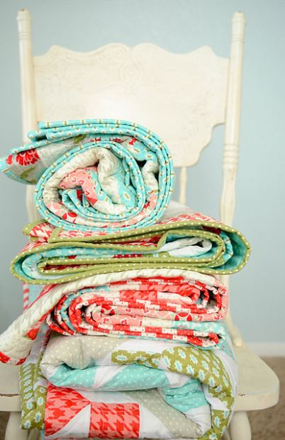 Stacks of Quilts on a White Chair