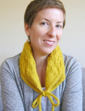 Smiling Woman on Couch Wearing Yellow Scarf