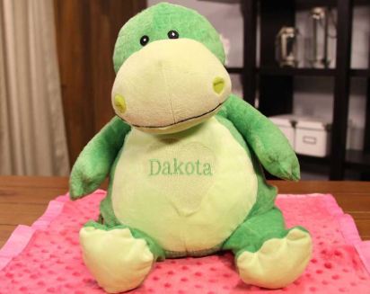 "Stuffed Dinosaur Toy With ""Dakota"" on Belly"