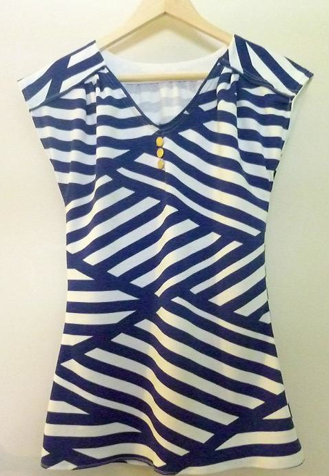 Nautical Blouse with Interweaving Stripes Hanging on Hanger