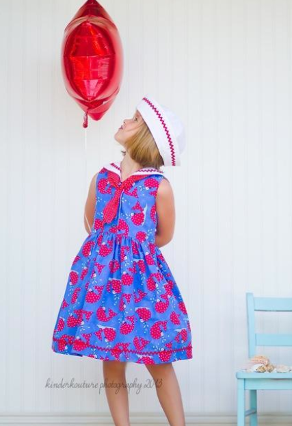 Little Girl in Sailor Dress Looking at Balloon