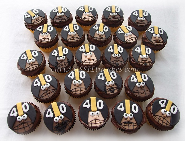 Cupcakes Decorated Like Football Player Heads
