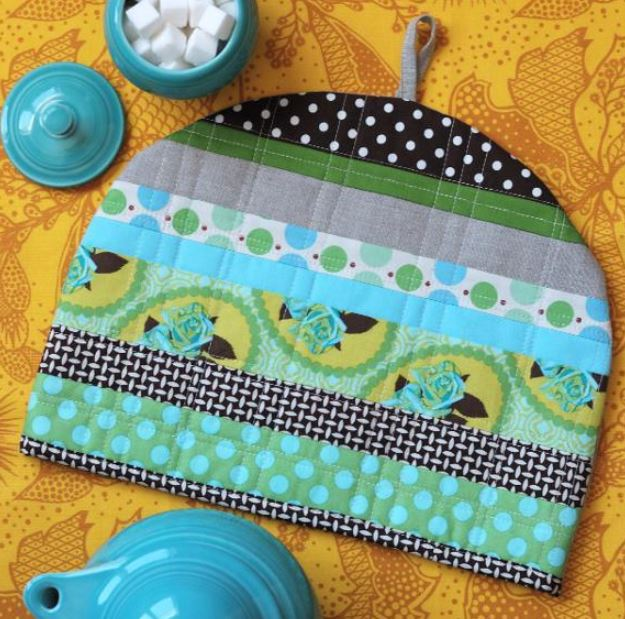 Quilted Teapot Cozy Next to a Pot of Sugar