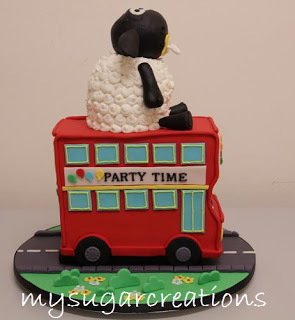 Cake in Shape of Double Decker Bus with Sheep on Top