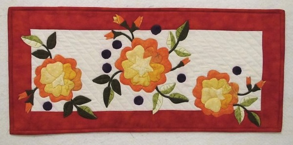 Quilt with Three Orange Flowers, Leaves and Buds