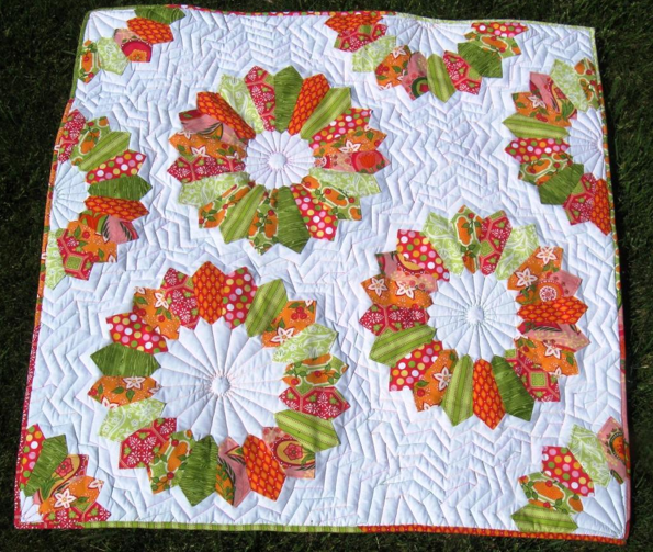 White Quilt with Colorful Flower Patterns