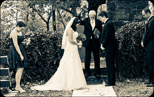 Preacher, Bride and Groom Praying During Ceremony