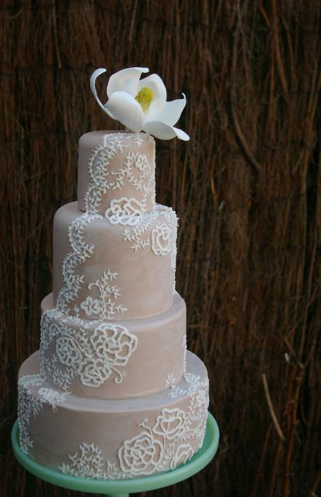 Pink Tiered Cake with White Vintage Lace and White Flower