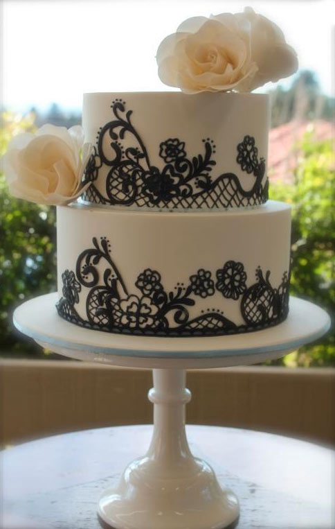 White Tiered Cake with Black Lace and White Roses