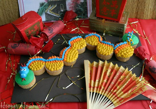 Cupcakes in Shape of Dragon, City Next to Asian Party Favors