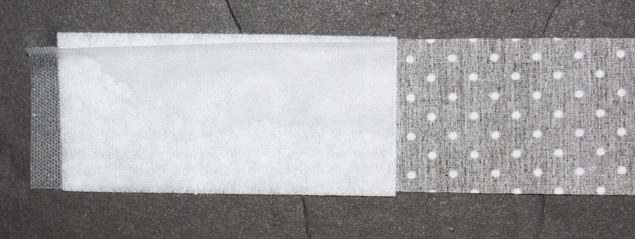 Fuseable Webbing Overlaying Fabric