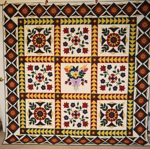 Folk Art Quilt with Flowers and Diamond-Patterned Border