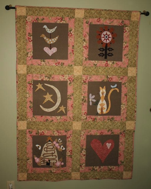 Quilt with Blocks Featuring Various Natural Figures