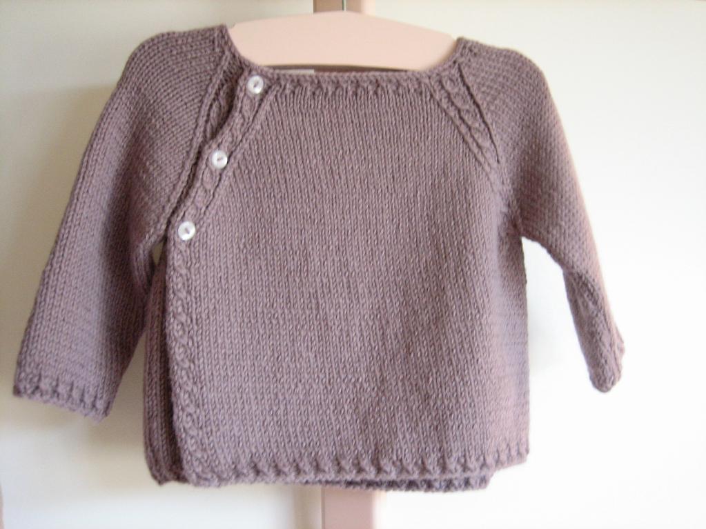 Purple Alpaca Sweater Hanging on Hanger