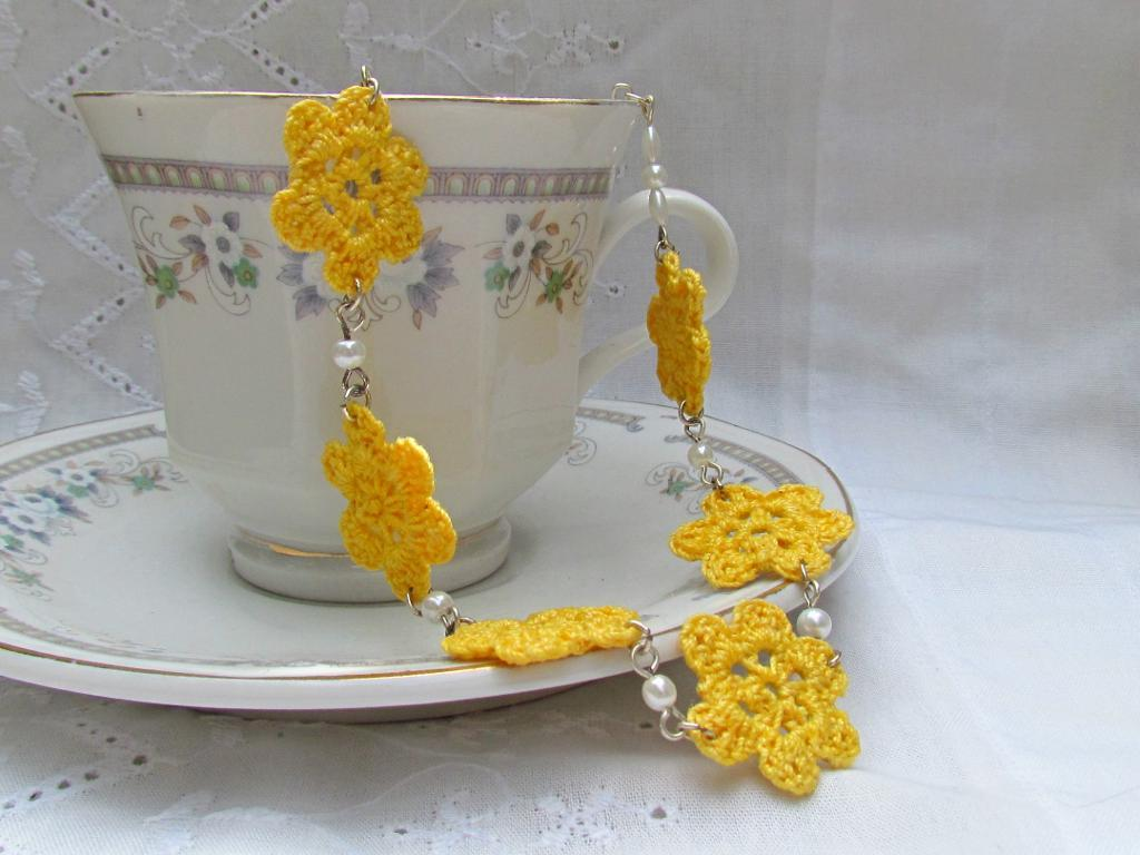 Necklace Featuring Crochet Detail, Laying in Teacup