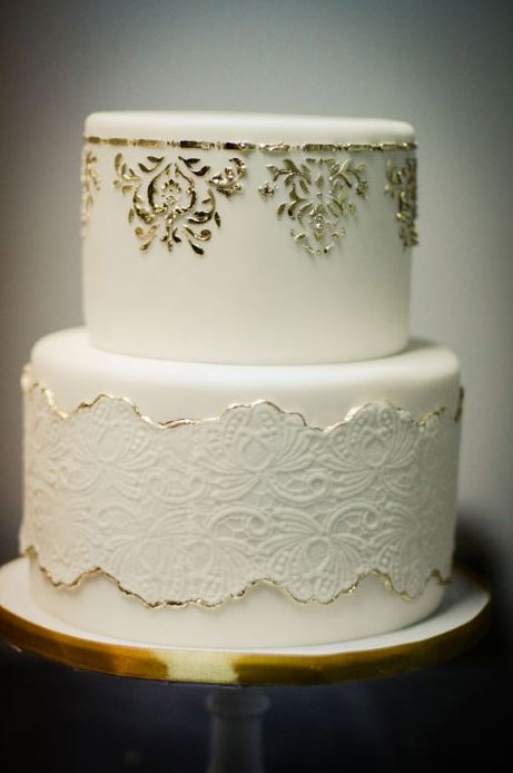 Two-Tiered White Cake with Gold and White Lace